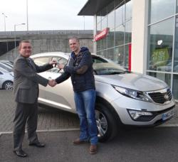 Mark Busby handing over the keys to the Kia Sportage to James Foad